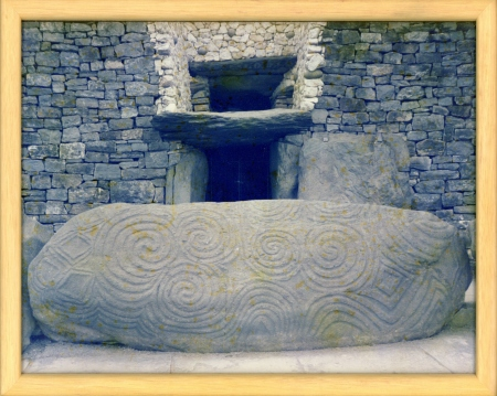 Newgrange, with unexpalined spark of light at centre of main entrance.